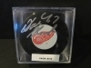 Dominic Hasek Autographed Puck (Detroit Red Wings)